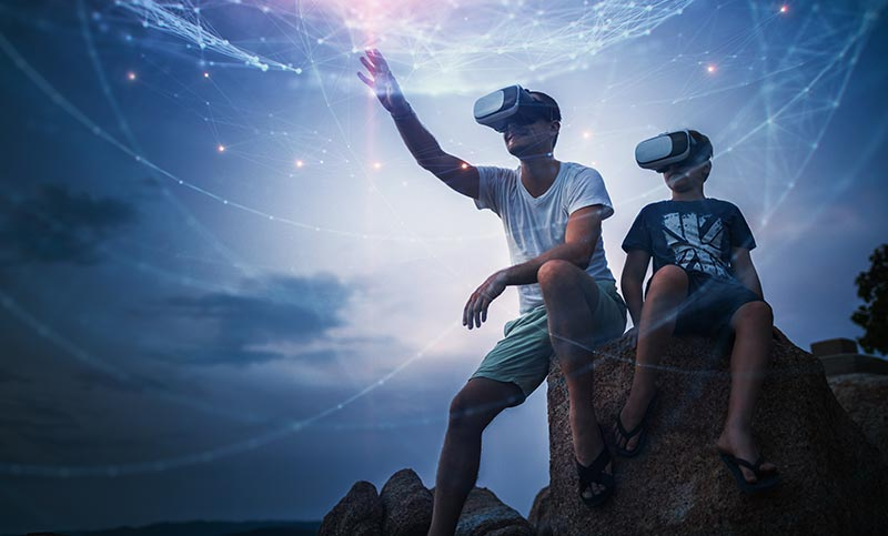 Father and son using virtual reality to view the universe