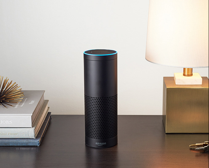 Amazon Echo voice device on side counter next to light